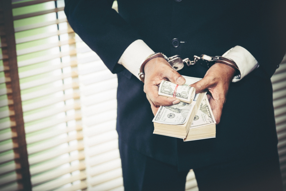 money in hand white collar